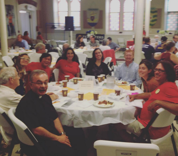 Father Michael J. Seavey with members of the SMWC at the annual Labor Day Breakfast in Portland, ME